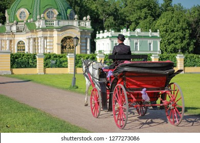 Coach with a coachman in the park