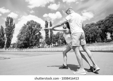 Coach and health. Summer activity and energy. Sport and fitness. Man and woman sunny outdoor on blue sky. Couple workout and stretching.