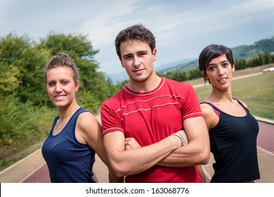 Coach with his athlete on the track - Stock Image