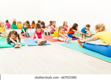 Coach and kids doing warming-up during gymnastics