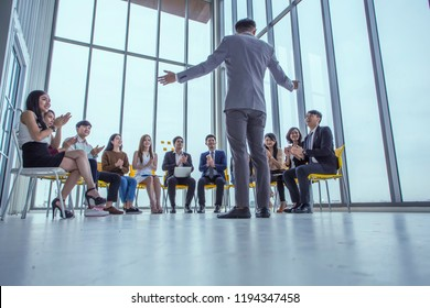 Coach leads the session with the business team sitting Listening to the talker at seminar in office .Business coach concept