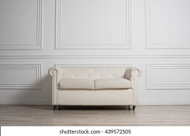Coach in Luxury White Interior with Wooden Wall Panels
