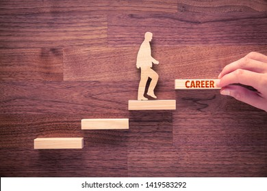 Coach motivate to career growth. Hand with the last peace of stair and person made from wood and wooden stairs, the last with text career.