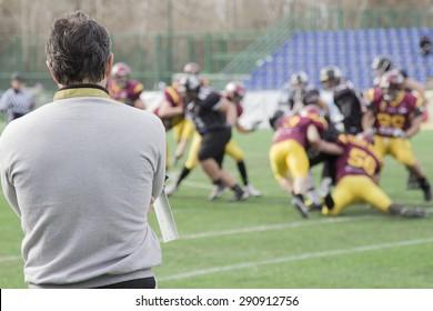 Coach observing football match
