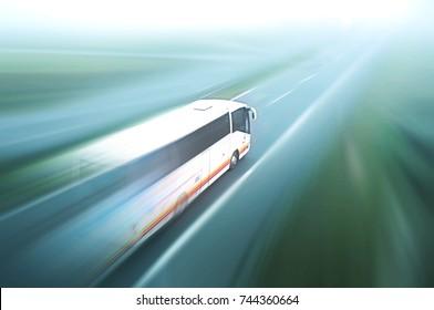Coach on asphalt road motion blur
