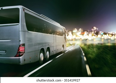 Coach on a coutry road at night