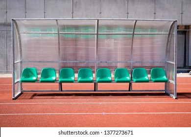 Coach and reserve benches in soccer stadium