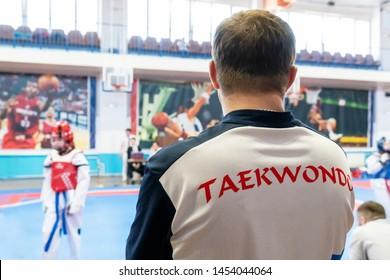 coach Taekwondo follows the fight of Taekwondo in the background of Taekwondo closeup