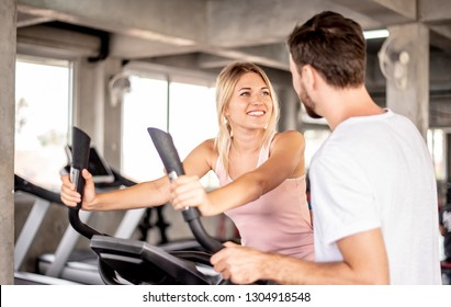 coach teaches correct using fitnes equipment,Portrait Fitness coaches are controlling the training equipment