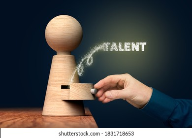 Coach unlock and open hidden talent - motivation concept. Coach (manager, mentor, HR specialist) open drawer from wooden figurine, there is hidden talent going out.