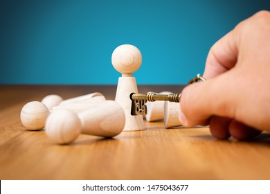 Coach unlock potential - motivation to personal development concept. Coach (manager, mentor, HR specialist) unlock leader potential and talent represented by wooden figurine and hand with key.