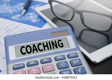 COACHING Calculator  on table with Office Supplies. ipad