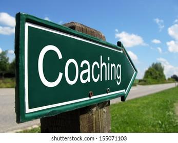 Coaching signpost along a rural road