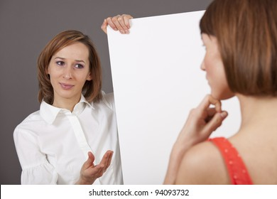 coaching talk - woman holding a blank board talking to a customer