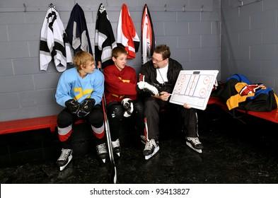 Coaching Teenage Hockey Players in Locker Room