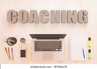 Coaching - text concept with notebook computer, smartphone, notebook and pens on wooden desktop. 3D render illustration.