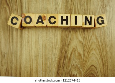 coaching word made from wooden cubes with letters alphabet