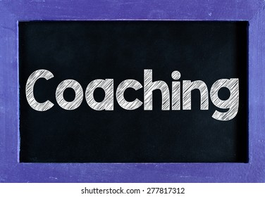 Coaching word On blackboard background