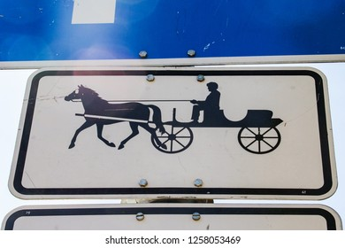 Coachman with a carriage road sign, traffic sign