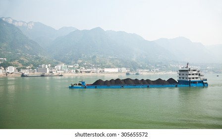 Coal barge sailing along the Three gorges region of Yangtze river in China