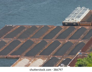 Coal barges at a dock.