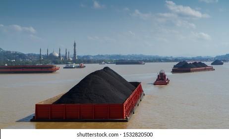coal barges at Mahakam river, Samarinda, East Kalimantan, Indonesia