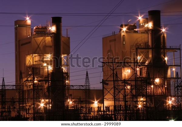 Coal burning power plant at night