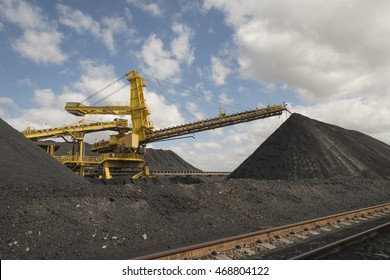Coal conveyor  belt stacking the coal into a pile ready for loading on a ship at Kooragang Island, Newcastle,New South Wales Australia
