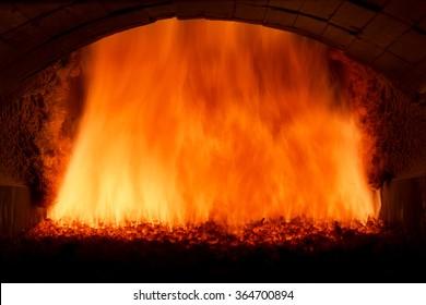 Coal fire inside steam boiler