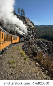 Coal fired steam train climbs the mountains in Colorado.