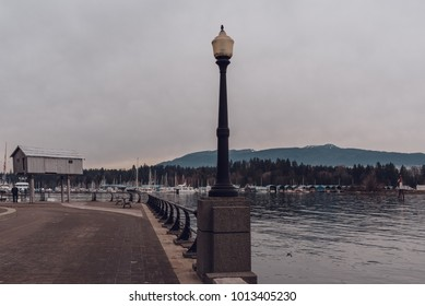 Coal harbour bay - waterfront in downtown with mountains in background. Vintage film look.