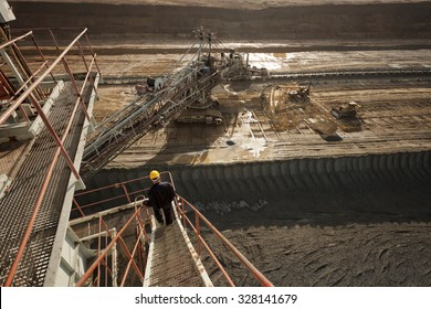 Coal mine field photographed with a wide angle lens from a top of huge drill machine. Bird perspective.