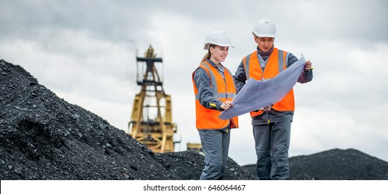 Coal mine workers in an open pit