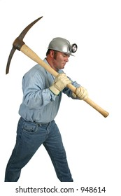 A coal miner using a pick ax in the mines.