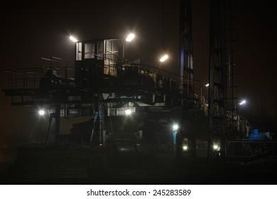 Coal mining machinery night, lamp light