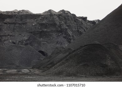 Coal mining at an open pit. Pile of black coal pieces