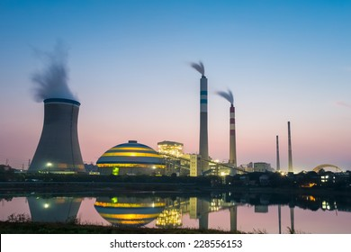 coal power plant in nightfall , industry landscape