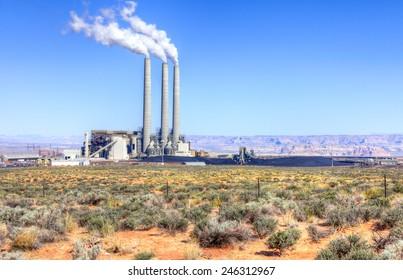 Coal power plant with smoke stacks.
