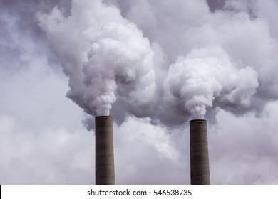 Coal Power Plant Smokestacks Emitting Pollution Into the Air