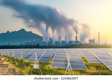 Coal power plant and  Solar energy at Solar panels (solar cell) in solar farm with sun lighting to create the clean electric power