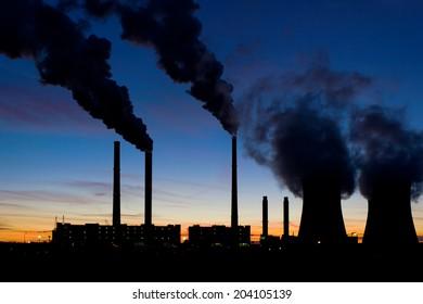 Coal power plant under evening sky