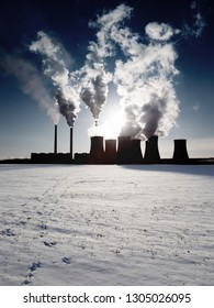 coal power plant at winter sunset
