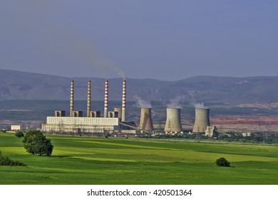 Coal power station in the middle of green fields. Environmental poster. Greenhouse gas emissions.