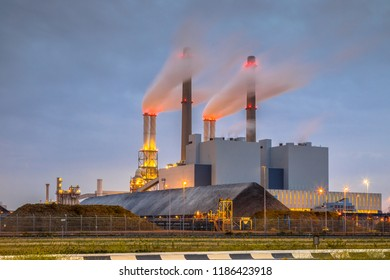 Coal powered electicity power plant in Europoort area with coal supply in foreground, Maasvlakte Rotterdam Netherlands