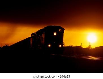 A coal train at sunset.