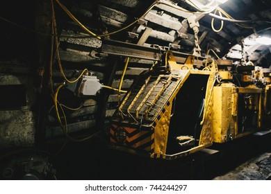 Coal transport train in underground coal mine tunnel