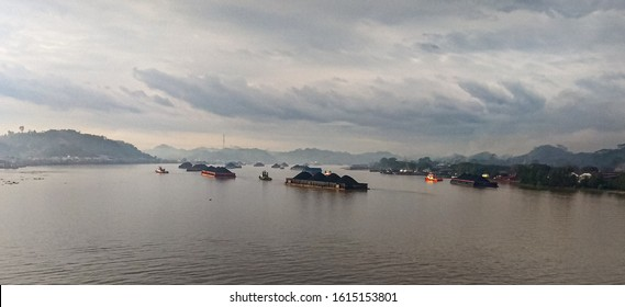 coal transporting barges neatly lined up in Mahakam river with selective focus photo
