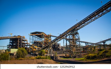 Coal wash plant, conveyors move coal around coal processing plant to wash coal in Queensland Bowen Basin. Fossil fuel industry, Environmental challenge, Climate Change. Logos removed in Photoshop.