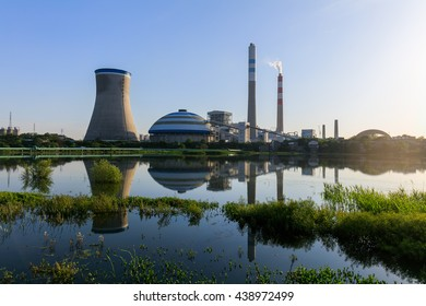 Coal-fired power plant reflection in a lake , industry landscape