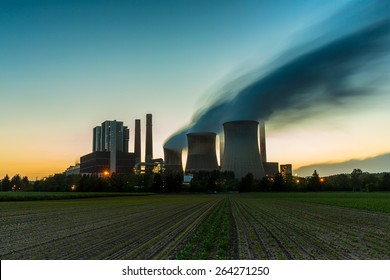 Coal-fired power plant at sunset